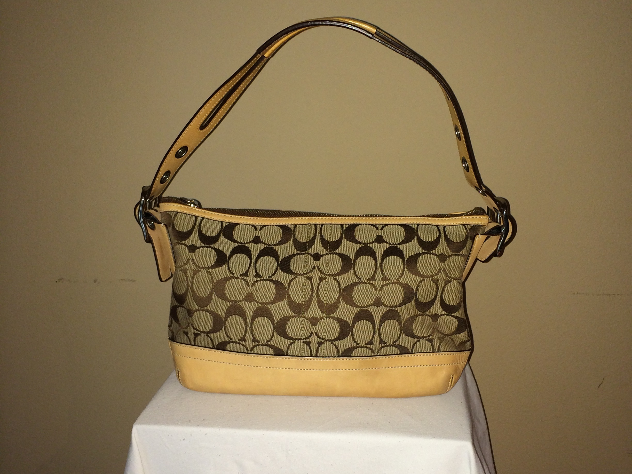 Tan Monogrammed Coach - front